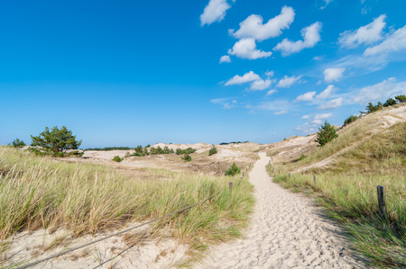 duna: Blue sky with few clouds over footpath through sand dunes