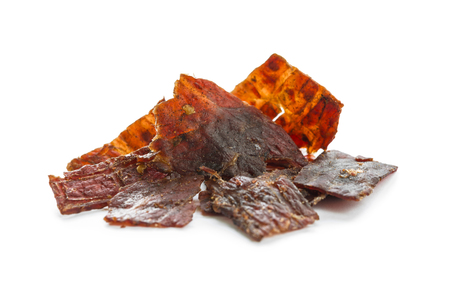 Close-up shot of beef jerky portion isolated on white background