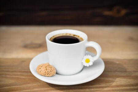 Cup of black coffee with biscotti arranged on wooden table 版權商用圖片
