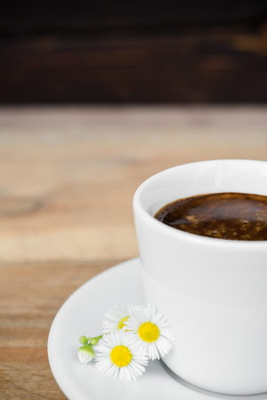 Cup of espresso coffee with daisy flower arranged on old rustic wooden table 版權商用圖片