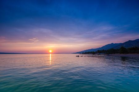 Sunset over Adriatic Sea with colourful dramatic sky near Starigrad in Dalmatia, Croatia - color grad filters used.