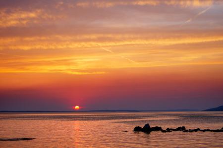 Sunset over Adriatic Sea with colourful dramatic sky near Starigrad in Dalmatia, Croatia.