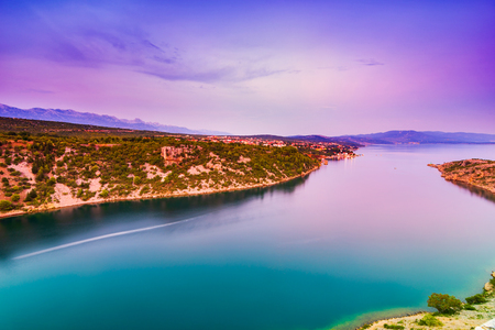 Colorful wide angle scenic view over Novigrad Sea and Maslenica town from Maslenica bridge in Dalmatia, Croatia. Wide angle and long exposure image.