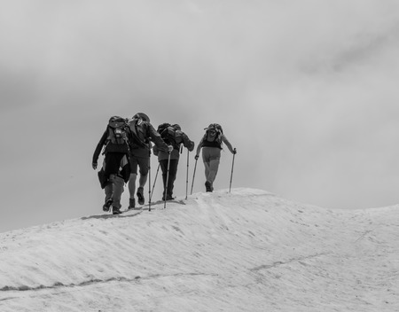 The five mountaineers climbing to the top of the mountain