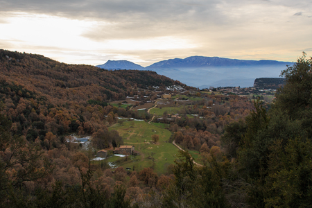 The brown of the Autumn mixes with the green of the valley