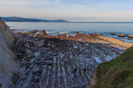 The Flysch, the rock formations of the beach of Zumaia or Itzurun in Guipuzcoa Foto de archivo - 116635506