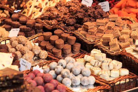 Black chocolate shop in the spanish market Boqueria in Barcelona, Spain