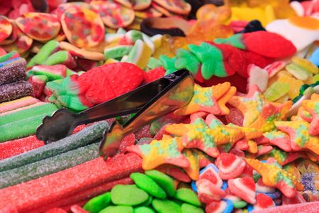 Metal tweezers to catch sweets of all colors