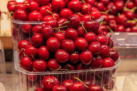 Set of red cherries in a plastic basket