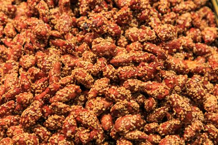 Pile of almonds with sesame seeds at the Boqueria Market. Food concept