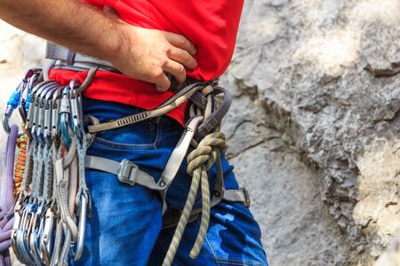Climber harness with hanging express belt