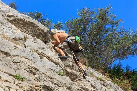 Senior climber with white slave hair