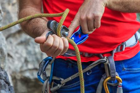 Climber passing rope by climbing insurer
