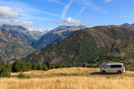 Durro, Spain; 09 25 2019: Volkswagen Caravelle T6 van parked on the mountain with clouds
