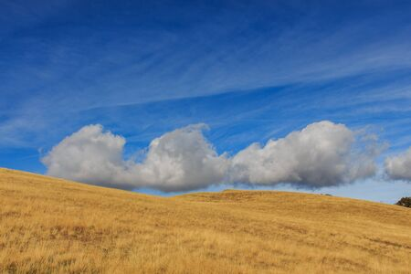 Clouds with shapes in blue sky with brown mountain.Nature concept