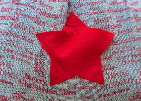 Red star in cloth sack with Christmas words. Christmas concept