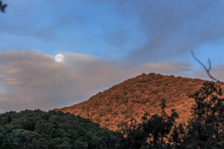 Full moon with mountain at sunrise.Nature elements concept Foto de archivo