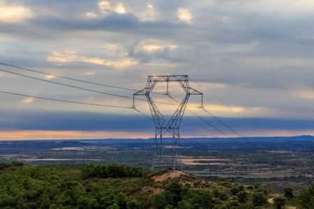 Iron tower of electricity on the mountain with sunrise