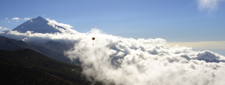 cloudscape and paragliding Stock Photo