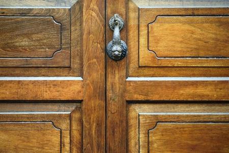 knocker in old wooden door