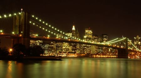 Brooklyn Bridge by night and the Hudson River Stock Photo - 5800949