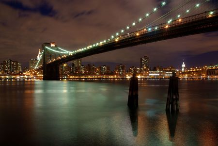 Brooklyn Bridge by night and the Hudson River Stock Photo - 5801074