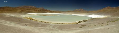 Lake with salt flats during a jeep tour of Uyuni in Bolivia photo