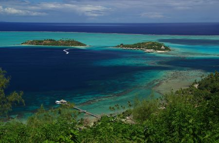 5 star hotel of Tahiti with bungalows on stillts over the lagoon and the cristal water. photo