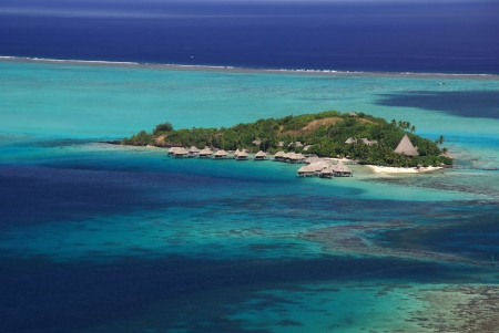 5 star hotel of Tahiti with bungalows on stillts over the lagoon and the cristal water. Stock Photo - 6536355