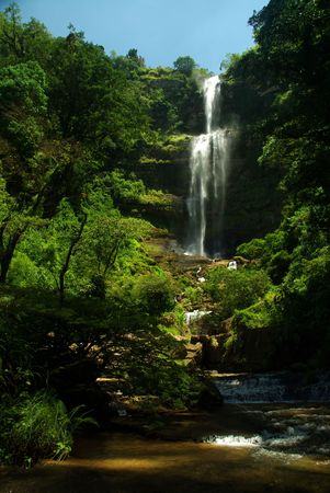 cascade: A  tall cascade near the extreme sports capital of Colombia