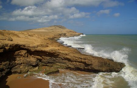 azucar: The coastal desert of la guajira near the rock formation of the pan de azucar Stock Photo