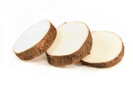 starchy food: Yuca root slices isolated on a white background