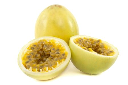 Whole Passion Fruit and opened in two on white background photo