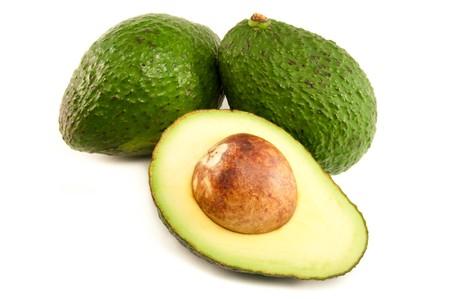 guacamole: Opened Avocado on white background