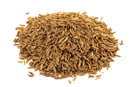 Caraway or carvi seeds used in oriental cuisine isolated on white background photo