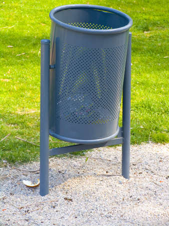 wastebasket: A metallic wastebasket. Located in a park in Granollers.