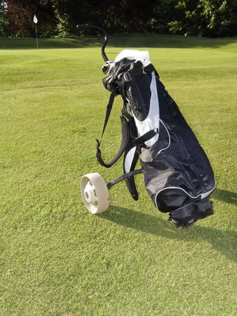 golf equipment on green and hole as background Stock Photo - 4906841