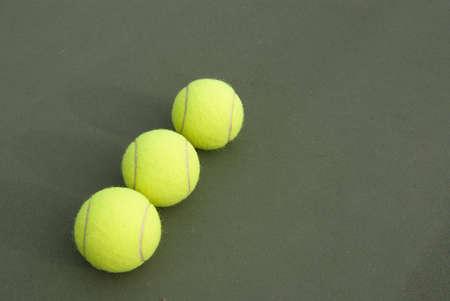 Three tennis ball on the court