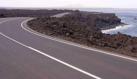 Coastal road at Lanzarote island Stock Photo