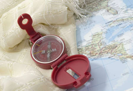 A Red open compass on a map Stock Photo