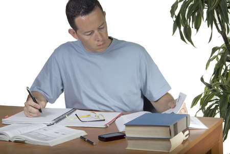 A young student preparing his final exams Stock Photo