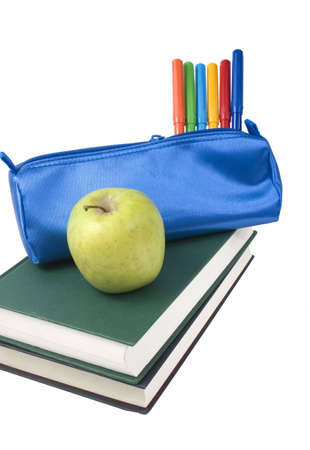 A Blue school case with color pens and a green apple.