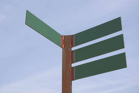multidirectional: Green blank directions panels on a blue sky Stock Photo