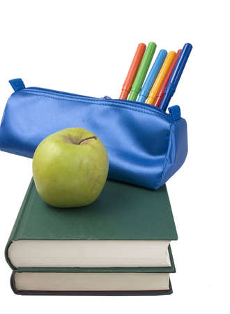 A Blue school case with color pens and a green apple. photo