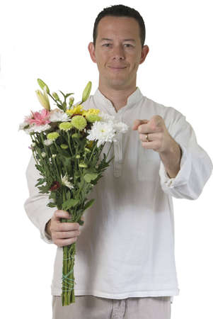 Portrait isolated on white. Young man want to give you a bouquet and sending you a kiss. Stock Photo - 5595828