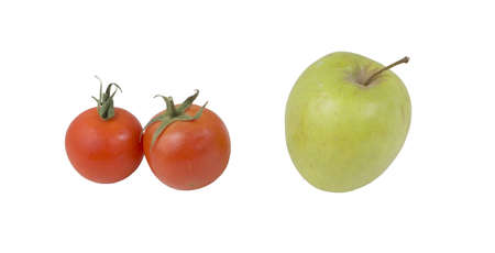 Red tomatoes and green apple isolated on a white background