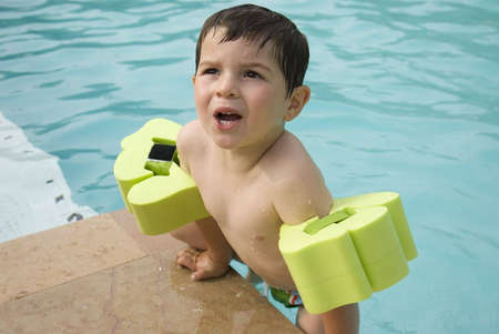 A kid on a swimming pool