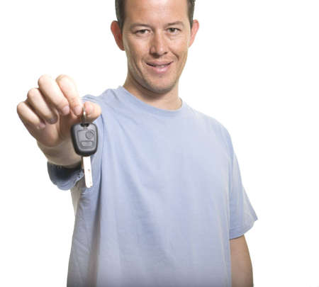 Casual Young Man Holding Out Car Key ( focus on face )