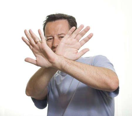 Man trying to protect himself with his arms Stock Photo
