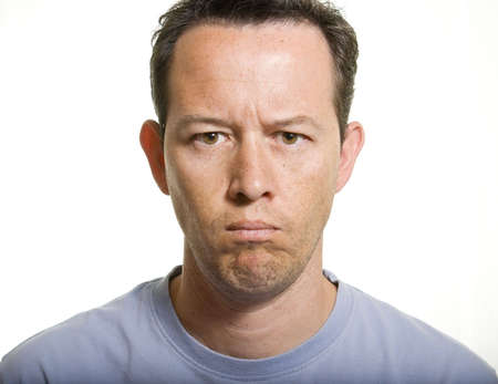 Serious man portrait on a white background Stock Photo